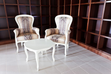 two chairs in hall