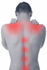 man suffers from pain in the spine and shoulder