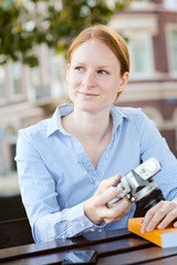 Woman Studies Photography as a Hobby