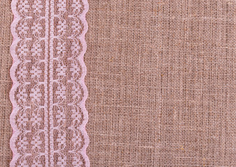 Background of burlap with pink lace