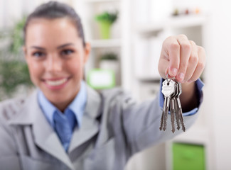 Realtor is giving the keys to an apartment, focus on the keys
