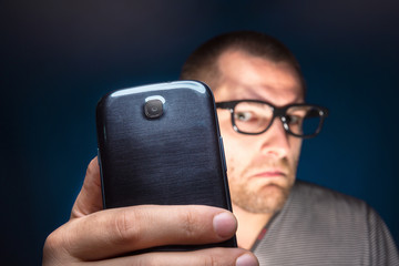 Man looks at his smartphone