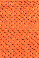 Orange roof tiles of a old built house