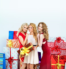 Three beautiful women with a lot of gifts