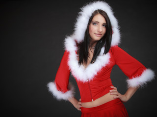 Portrait woman wearing santa clause costume on black