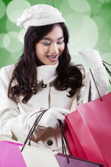 Attractive woman looking gift bags