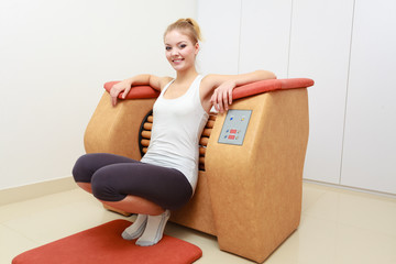 Girl in sportwear relax massage equipment healthy spa salon