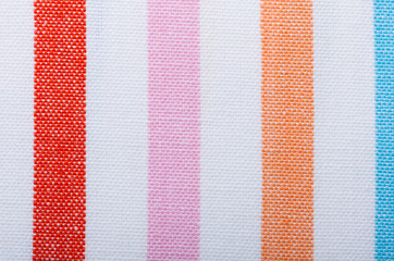 Closeup of colorful striped textile as background or texture