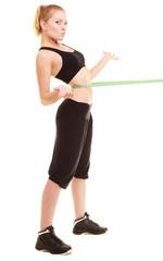 diet. slim blonde girl with measure tape measuring waist