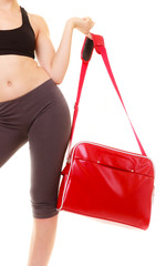 Sport. Red gym bag of fitness sporty girl in sportswear