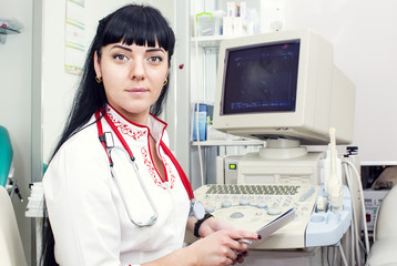 Doctor woman in the office of ultrasound