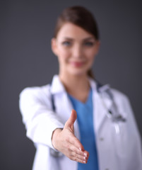 Female doctor's handshake , isolated on grey background