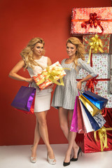 Gorgeous girlfriends presenting Christmas gifts