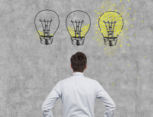 businessman looking on bulbs