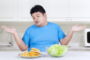 Overweight person with two kinds of food 2
