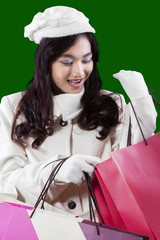 Pretty teenage girl opens gift bags