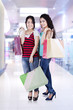 Two asian people with shopping bags