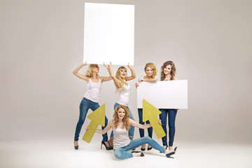 Alluring young women holding boards