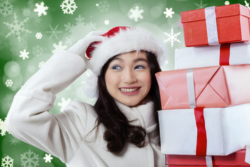 Young girl brings christmas gifts