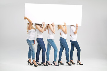 Shapely women carrying white board