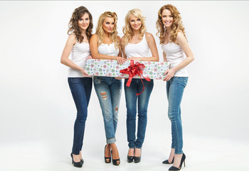 Attractive women holding a gift