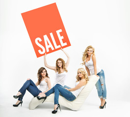 Attractive women promoting middle-season sale