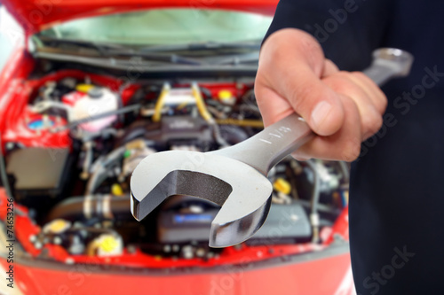 canvas print picture Hand of car mechanic with wrench.