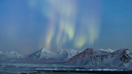 Arctic mountain landscape with Northern Lights