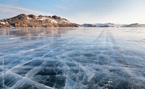 Leinwanddruck Bild Lake Baikal winter morning. Ice road on Olkhon island