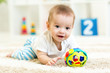 canvas print picture - baby boy playing with toys indoor