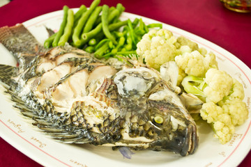 Steamed Tilapia fish garnish and vegetables