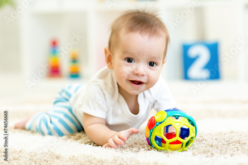 canvas print picture baby boy playing with toys indoor