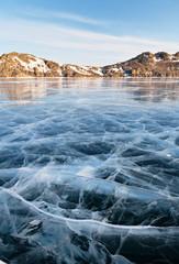 Baikal Lake. Sunny morning. Pattern on smooth ice