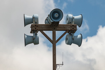set of megaphones on pole