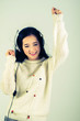 Asian woman teenager listing for dancing with Headphone