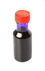 Liquid purple food color additive over white background