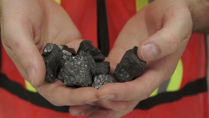 Miner Shows Carbon Graphite Ore