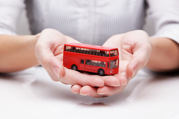 Bus in the hands of (concept)