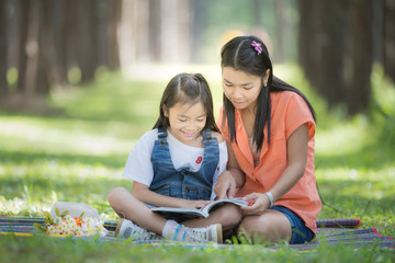 Mon and baby take a home work