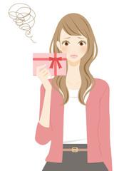 プレゼントを持った女性 悩む