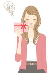 プレゼントを持った女性 困る