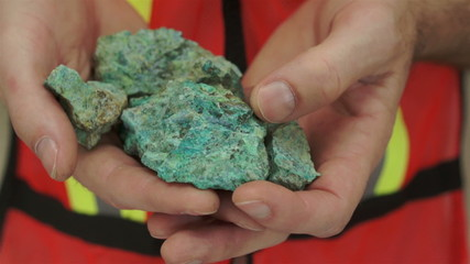 Miner Shows Copper Carbonate Ore
