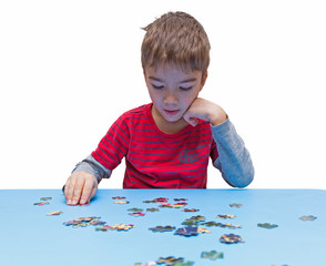 pensive child collects puzzles