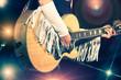 Leinwanddruck Bild - Woman guitarist in the country band