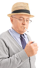 Vertical shot of a senior lighting up a cigarette