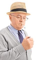 Vertical shot of a senior lighting up a cigarette