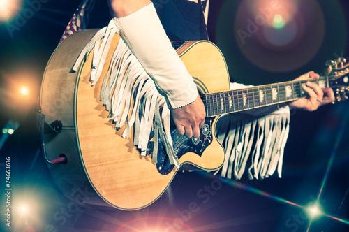 Leinwanddruck Bild Woman guitarist in the country band