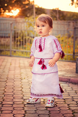 A girl dressed in Ukrainian at sunset