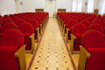 Empty conference hall. red chair