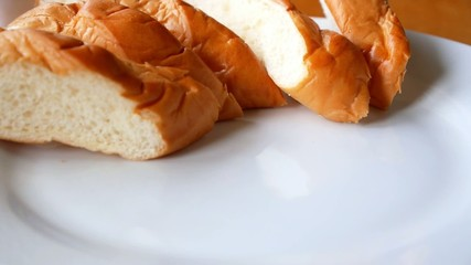 Close-up Serving Wheat Bread in White Plate.